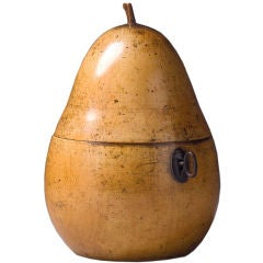 A FRUITWOOD TEA CADDY IN THE FORM OF A PEAR
