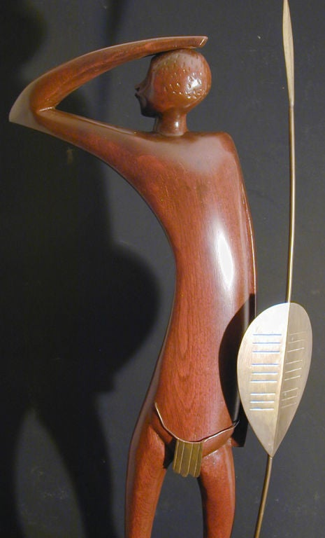 This African warrior, slender and attenuated, is a large and rare example of the stylized work of Karl Hagenauer and his contemporaries in Austria. It is beautifully executed in mahogany and brass.  One of Europe's most brilliant and inventive