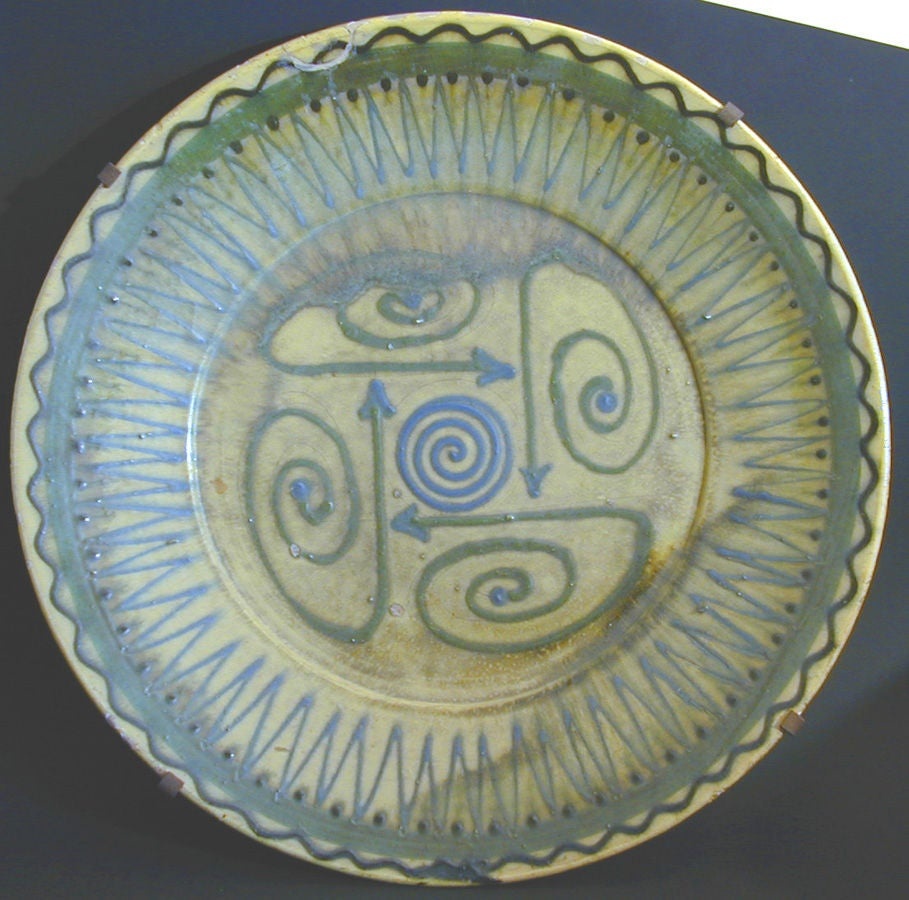 Highly unusual and graphically striking, this monumental charger or platter was created in Biot at a time when the French village vied with Vallauris in producing the best ceramic pieces of the era.  The geometric patterns in shades of acid green,