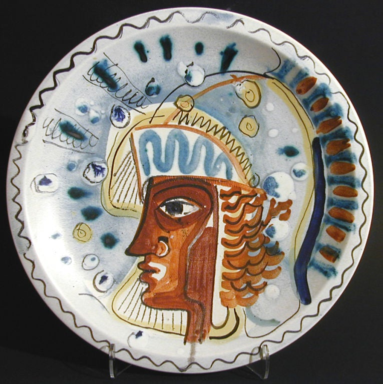 An important and early work by Carl-Harry Stalhane, this unique charger is Picassoesque in style and is glazed with brilliant colors.