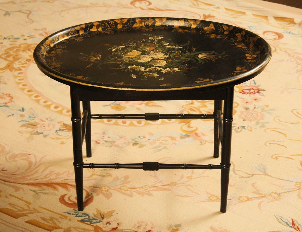 A finely painted and stenciled black lacquered metal tray, on a later matching bamboo turned stand.  The tray rests securely 'in' the stand, and can be lifted out as desired. Contact Dealer directly for best NET pricing, delivery quotes, and any