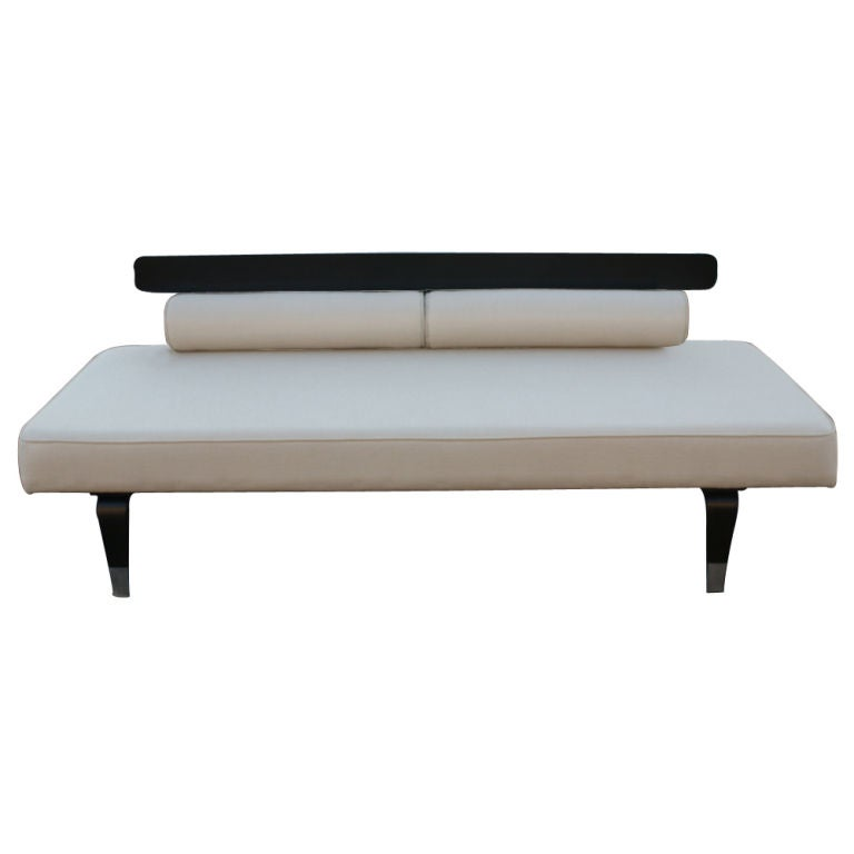 A Mid-Century Modern daybed made by Thonet. Ebonized, bentwood frame with silver finish feet. New upholstered in cream colored linen with two removable bolsters.
