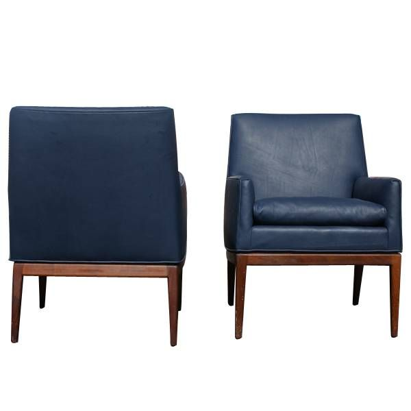this pair of jens risom leather and walnut lounge chairs is no longer