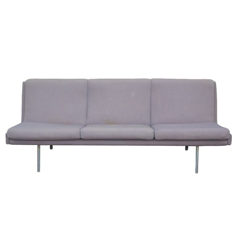 A Mid-Century Modern Danish sofa designed by Hans Wegner. A streamlined form without arms and tubular chrome legs. Upholstered in it's original lilac fabric.