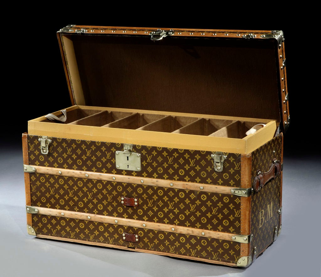Louis Vuitton, Paris: a superb and extremely rare 'Malle Chaussures, Grande Modele' (large shoe trunk) in L.V. 'Monogramme' fabric with all brass and leather trim, the interior with 3 removable trays, the trunk with capacity for 20 pairs of