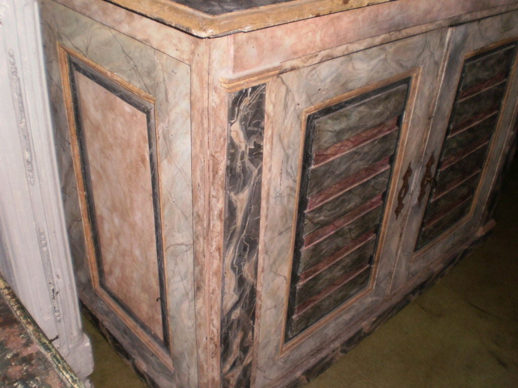 Beautifully detailed with clean lines 18th century faux marble painted two-door Tuscan buffet.