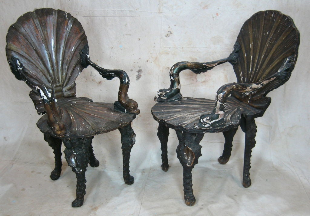 Pair of Venice Grotto armchairs with shell back dolphin arms and sea creature legs with nice worn finish.