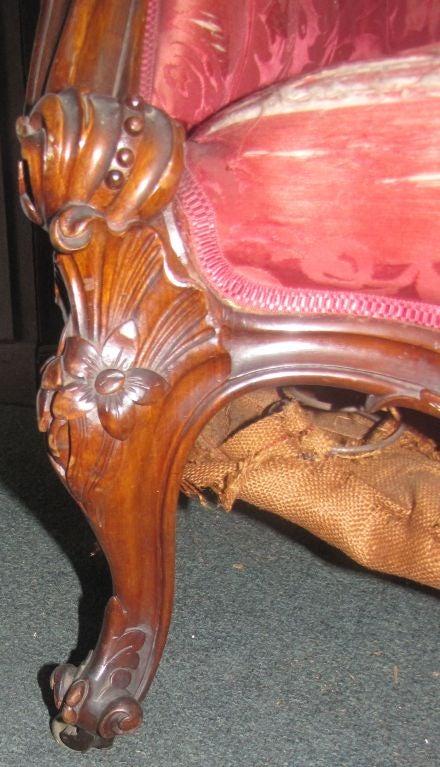 Wood Late Victorian carved walnut sofa