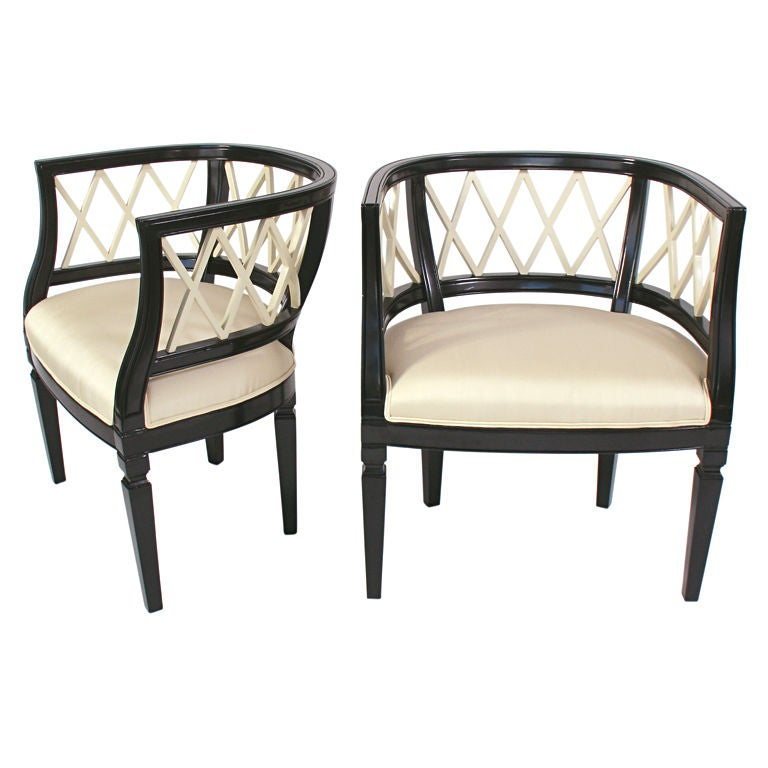 this elegant lattice back tub chairs in ebony and ivory lacquer is no