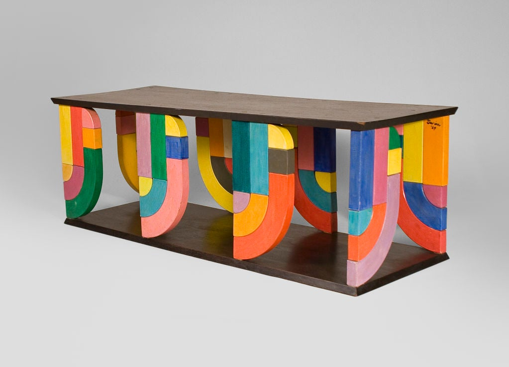 Two mahogany boards joined together by polychrome painted blocks in a whimsical pop-art design. Signed by the artist
