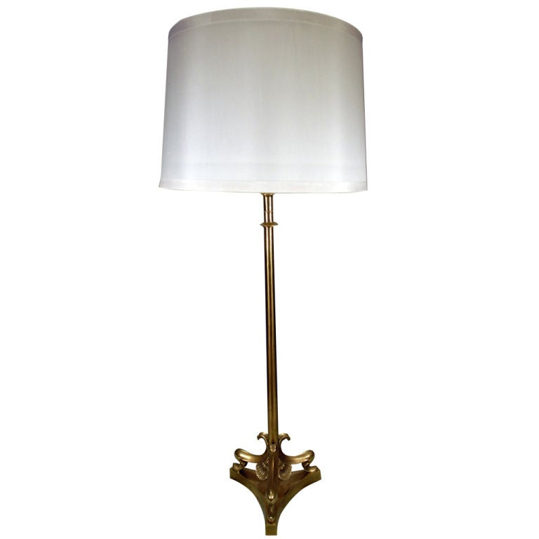 single tall brass table lamp with sea shell details for