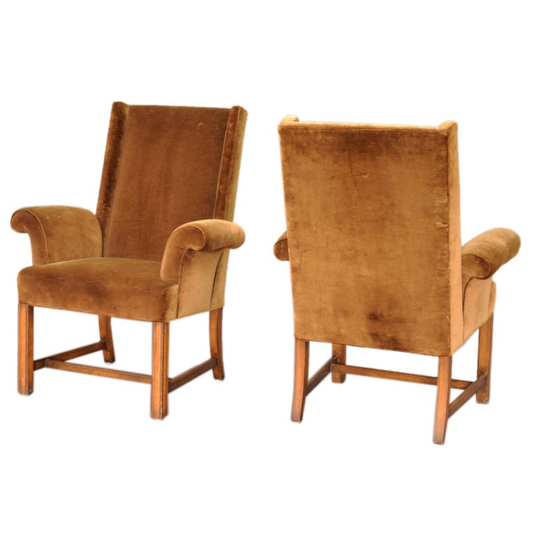 A Pair Of High Backed Arm Chairs In The Manner Of