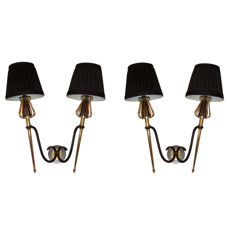 4 pairs of Sconces by Lunel available. circa 1940s. Priced by pair