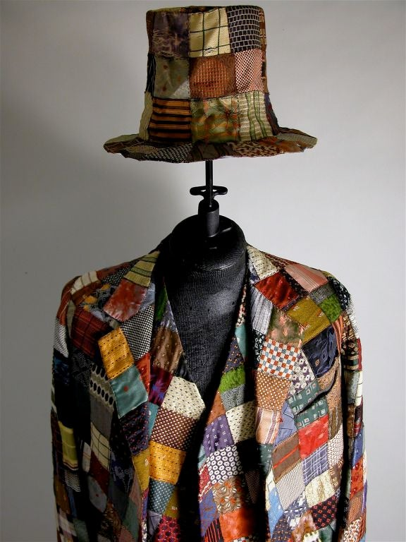Theatrical costume: this includes top hat, jacket, vest and pants covered in sown squares of silk textile. Likely from a vaudeville act.