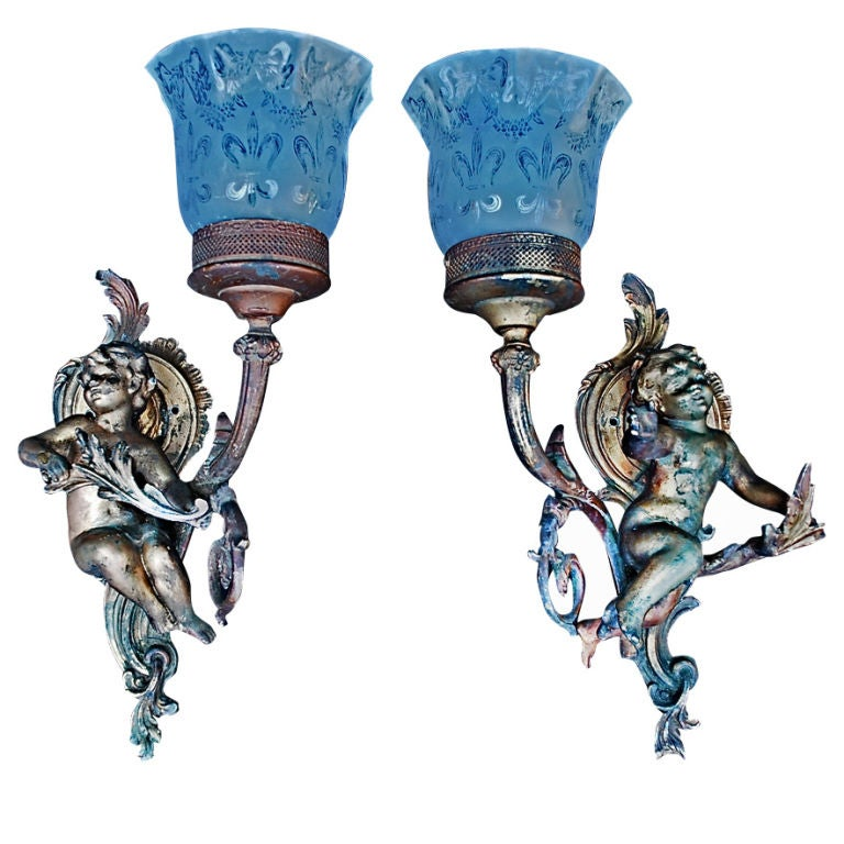 Antique pair of French cherub sconces For Sale