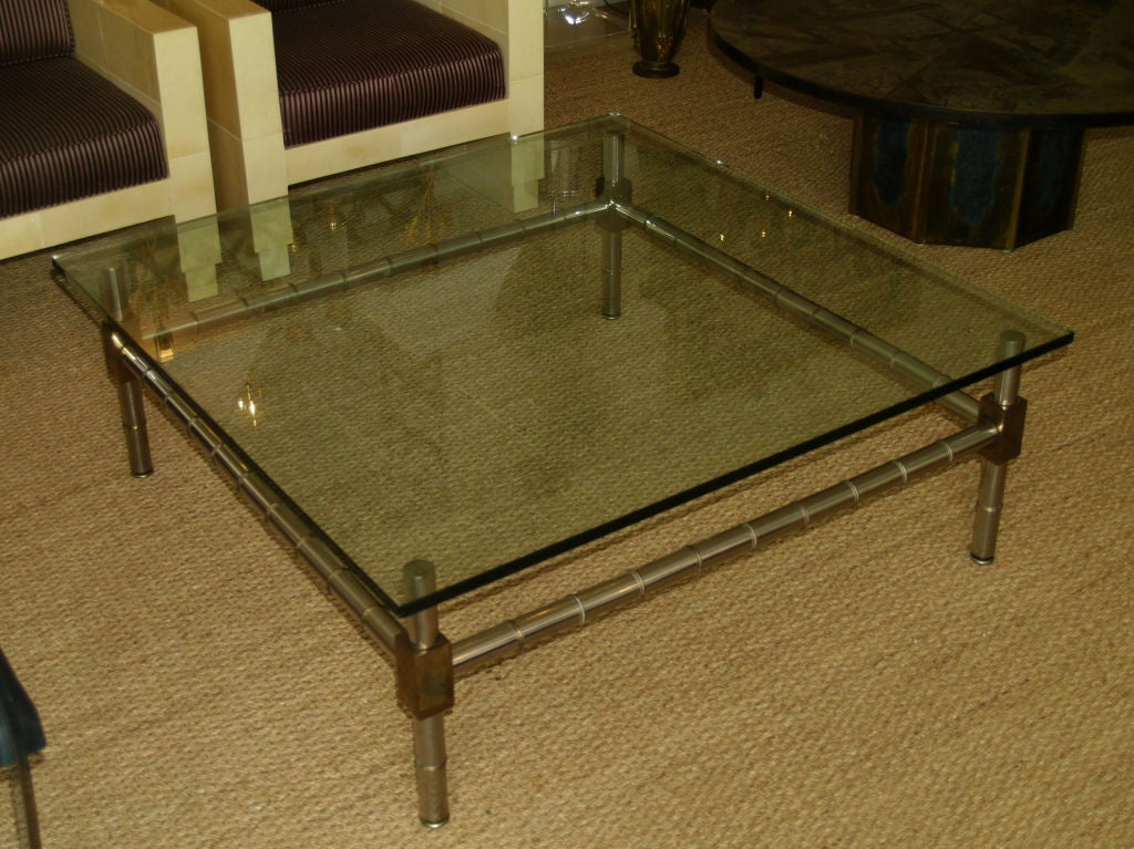 Hollywood Regency wonderful faux bamboo chrome and bronze coffee table.