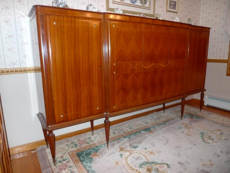 Part of a 9 piece dining suite, probably by Dassi, (available as a complete set) thi early 1950's Italian tall cabinet presents beautifully with herringbone pattern rosewood and mahogany veneer and rests on 8 tapered legs with brass sabots.  The top