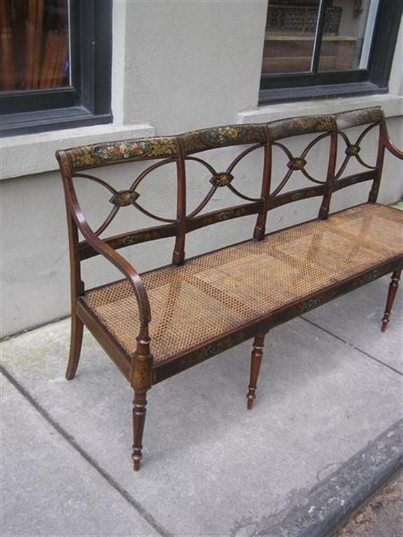 English Sheraton floral faux painted bench with cane seat and turned legs.