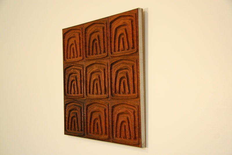 This panel is constructed of vintage Forms and Surfaces redwood tiles.  The frame is made of brushed stainless steel.  Redwood pieces have been oiled with a penetrating redwood oil.  This type of finish leaves the wood feeling like wood.  Many