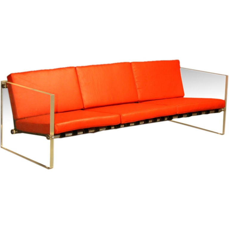 Solid lucite sofa with red leather cushions at 1stdibs