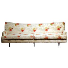 Large sloped back regency sofa in floral Hermes fabric