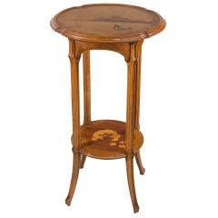 "A French Art Nouveau Carved Wood and Inlaid Marquetry ""Ombelle"" Occasional Table"