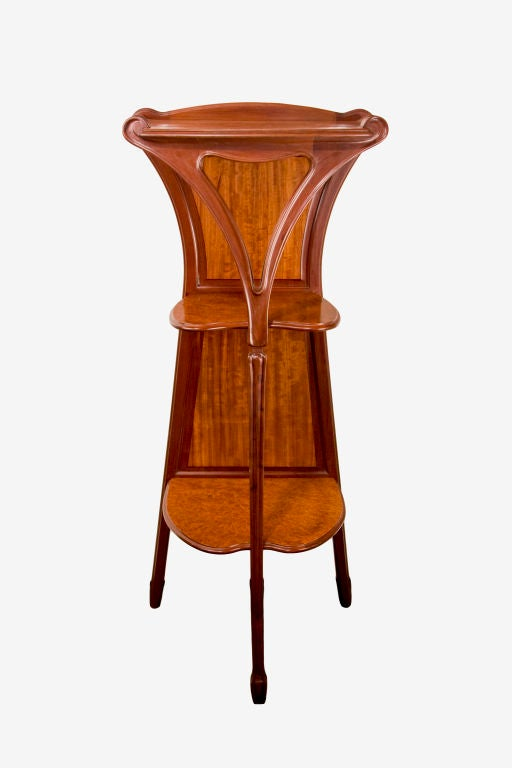 French Art Nouveau carved mahogany and burled walnut three tier display pedestal by, Louis Majorelle. The selette is signed,
