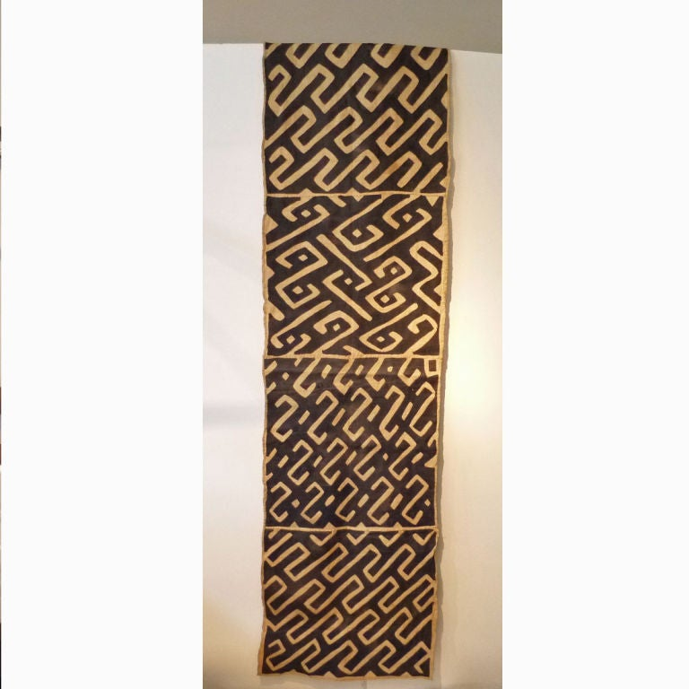 Handwoven Kuba cloth made of vegetable dyed raffia with raffia applique. Length of fabric can be used to make four double sided 25
