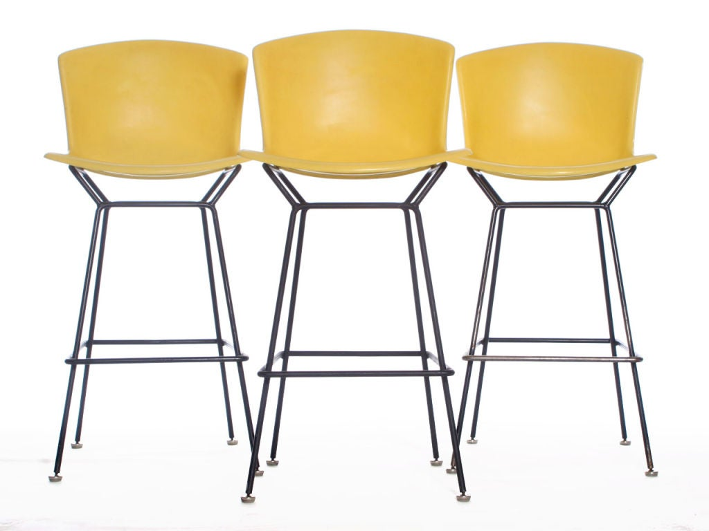 this lemon yellow stools designed by harry bertoia is no longer