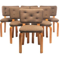 A Set of 8 Upholstered Dining Chairs Designed by Alvar Aalto