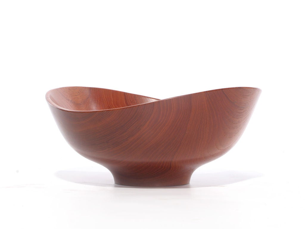 A modern design Classic - lathe turned teak salad bowl in the largest size, design by Finn Juhl crafted by Magne Monsen for Kay Bojesen.