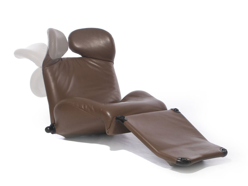 This multi-use chaise or low lounge chair has adjustable positions for the back and headrest. By tilting the base forward the armchair becomes a chaise lounge. Measures: Upright 40 5/8 x 33 x 31 5/8