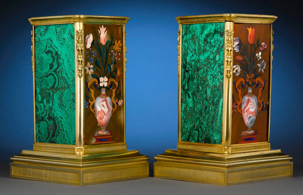 The exquisite art of pietra dura is at its absolute finest in this spectacular pair of Russian ormolu and malachite plinths. True works of art of the Restauration period, these plinths each feature a matching pietra dura mosaic crafted of the finest