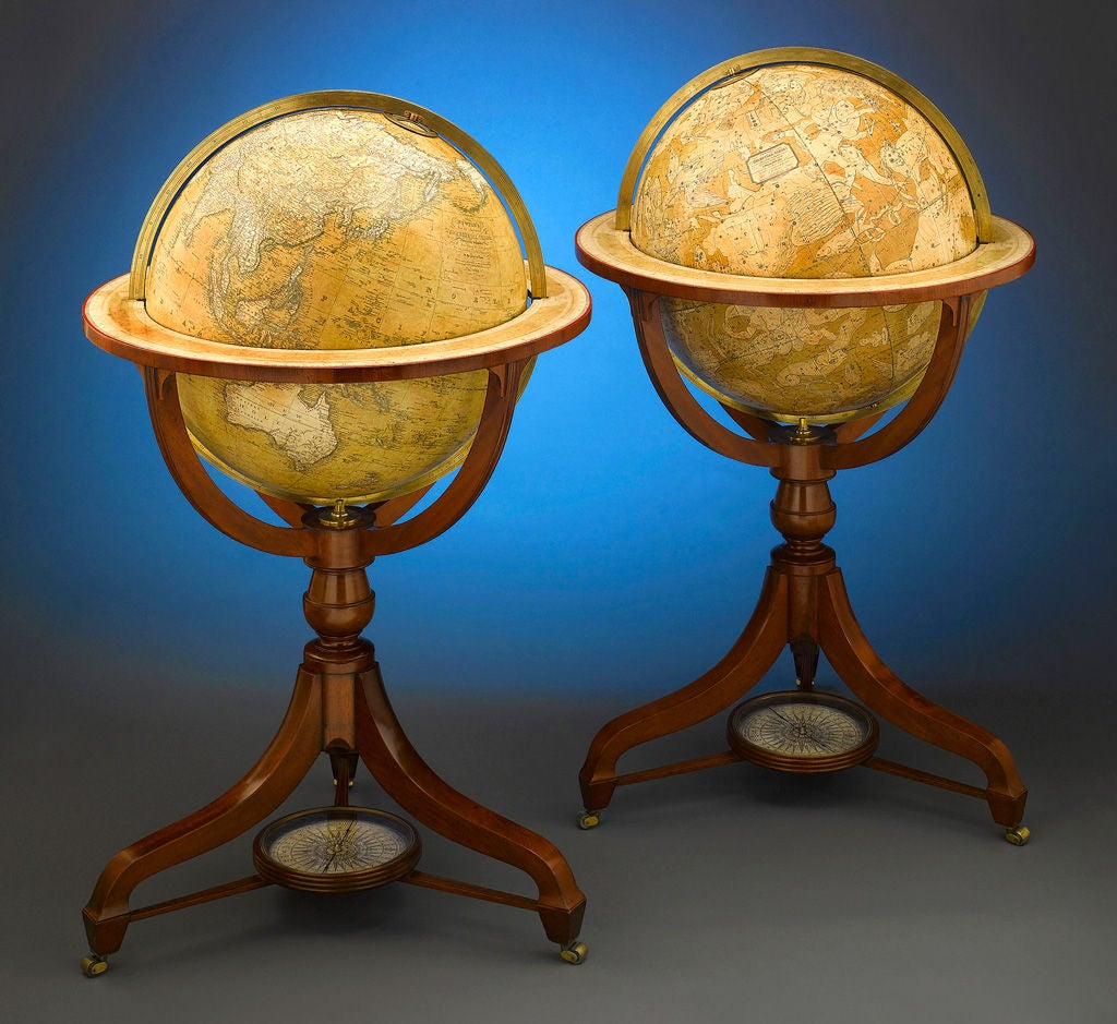 An extremely rare and important pair of 21 inch English globes by renowned cartographers John Newton and Son, one of the most important globe makers of early 19th century England. Representing the terrestrial and celestial landscapes, these spheres