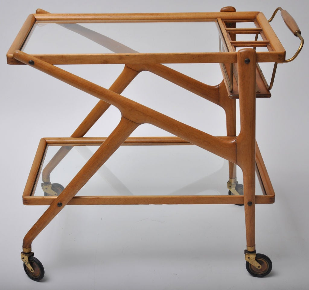 ITALIAN 1950S BAR CART - WALNUT AND BRASS.  IN THE STYLE OF CESARE LACCA.