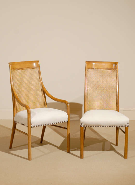 A great set of six (6) cane high back dining chairs by Drexel. The set includes two (2) host and four (4) side chairs, circa 1970. Excellent condition with new upholstery. The price noted is for the set.