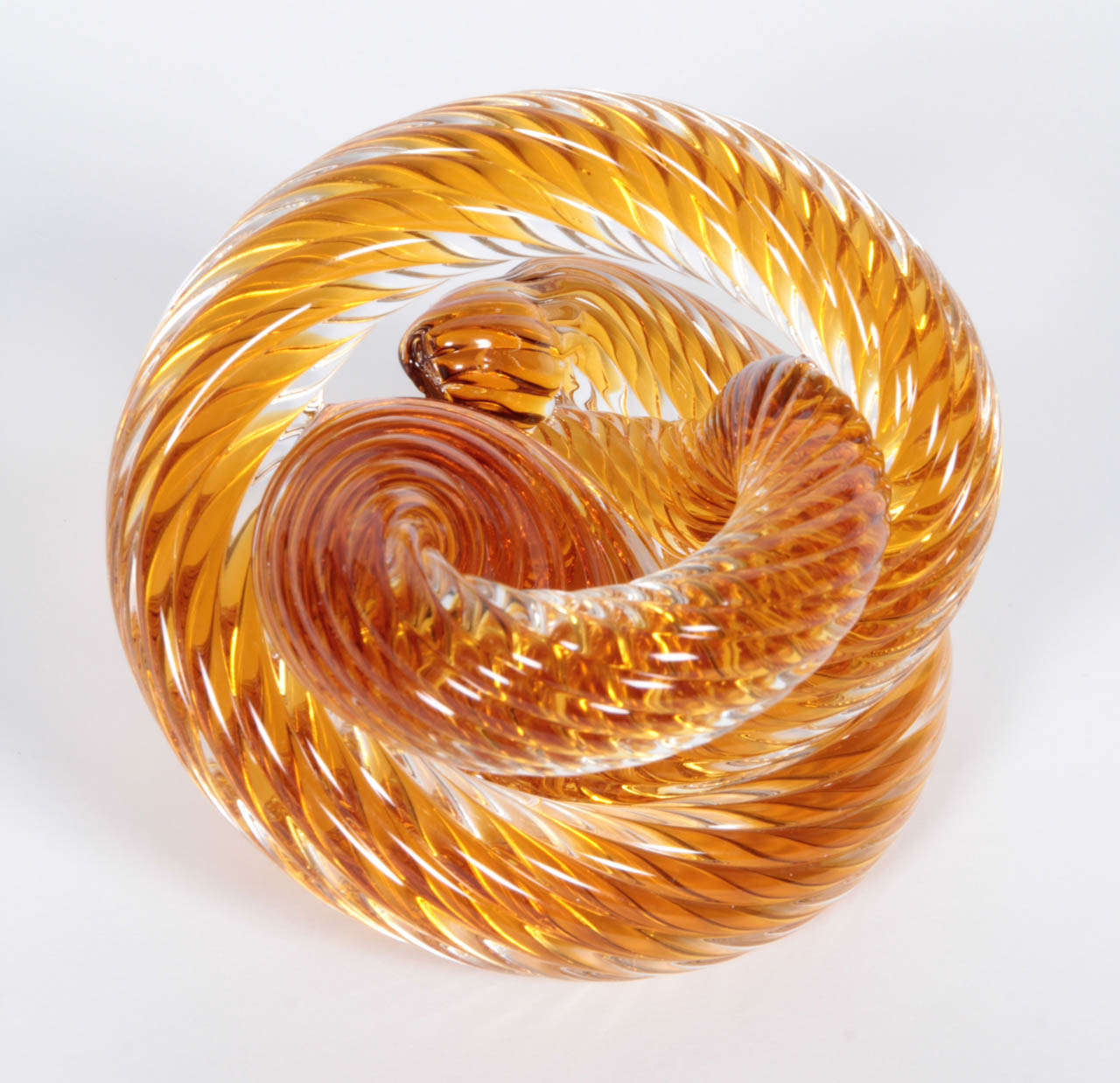 Tangerine-colored Murano glass coiled paperweight or small tabletop sculpture, Italy, circa 1970.