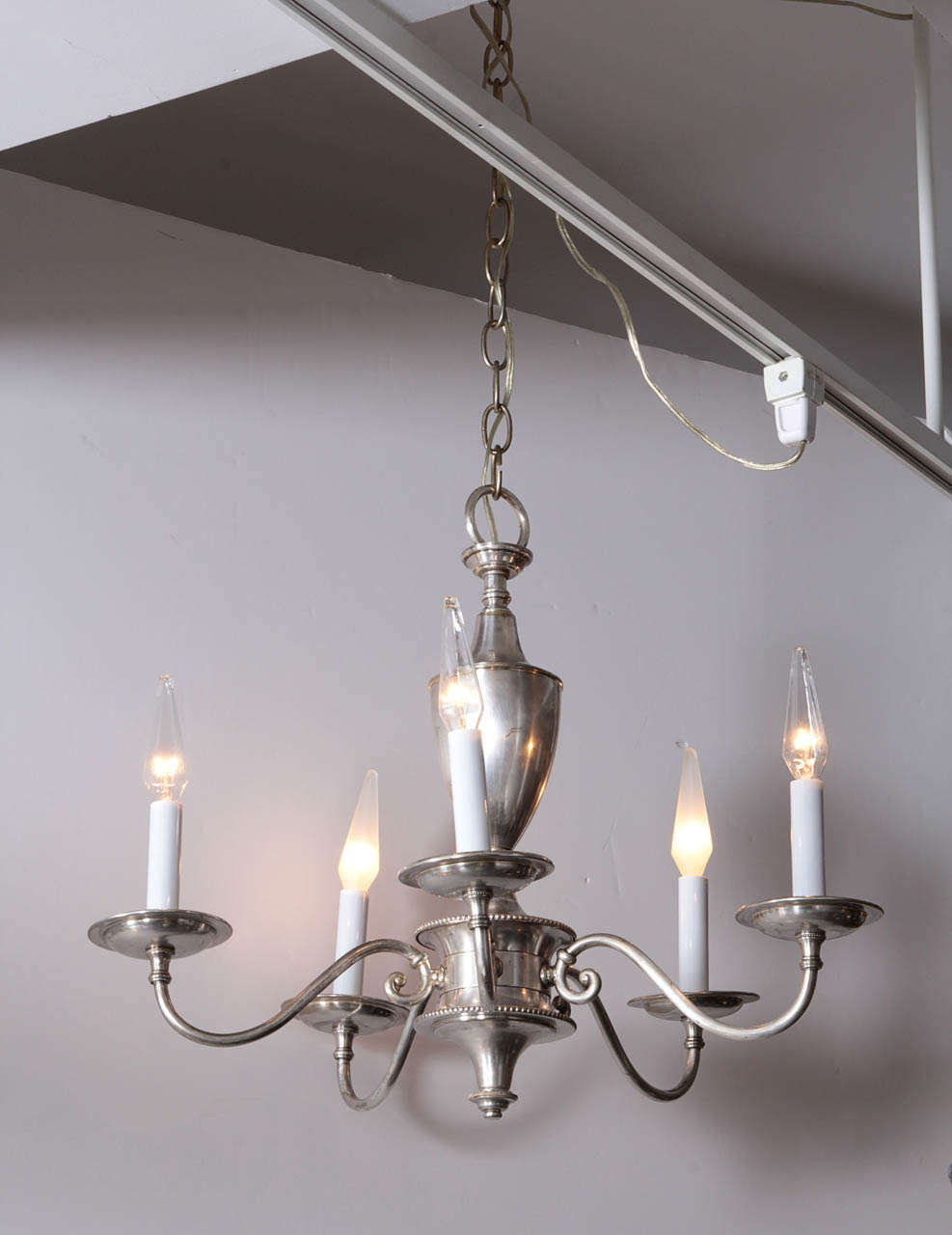 Tradition silver plate chandelier with five arms.  England, circa 1920.  Rewired for U.S. use; takes five candelabra base bulbs, 60 watts max each.