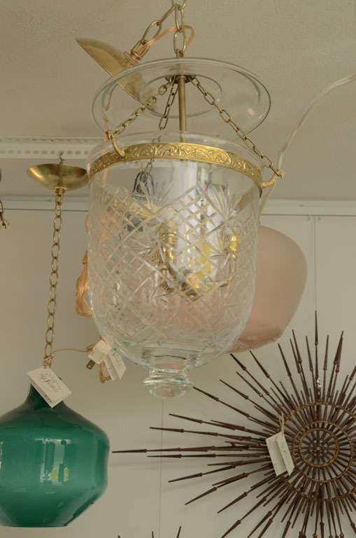 Etched bell jar pendent trimmed with brass.  Center arm accommodates 3 lights..
