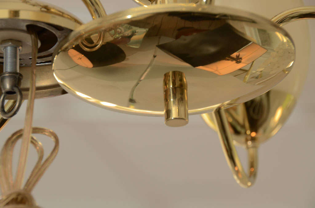 Five-Arm Brass Chandelier with Opaque Glass Globes In Excellent Condition For Sale In Bridgehampton, NY