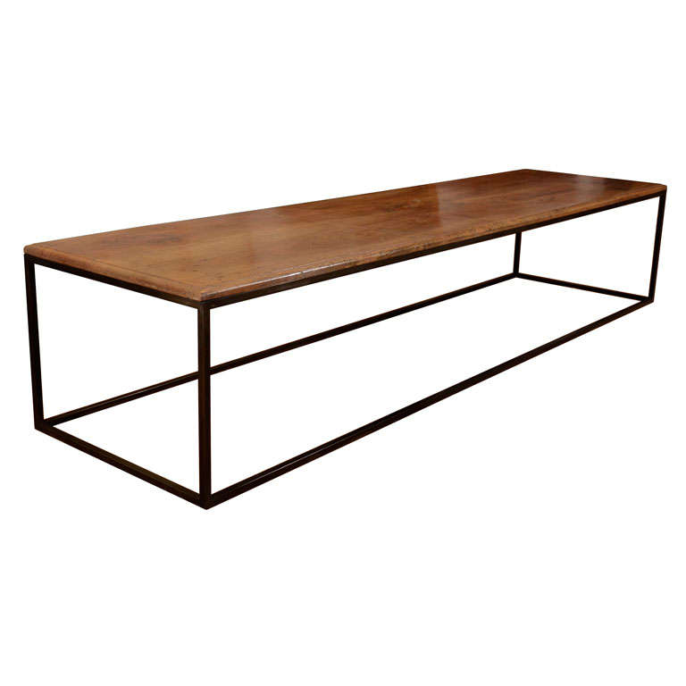 A Long Rectilinear Low Table With Contemporary Steel Base
