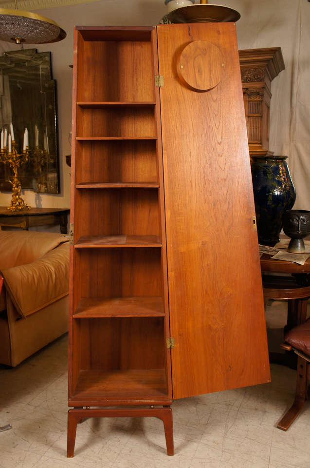 Obelisk form grandfather clock in teak, Danish, mid-century modern, with electric movement (working) and  interior fitted with shelves for convenient storage