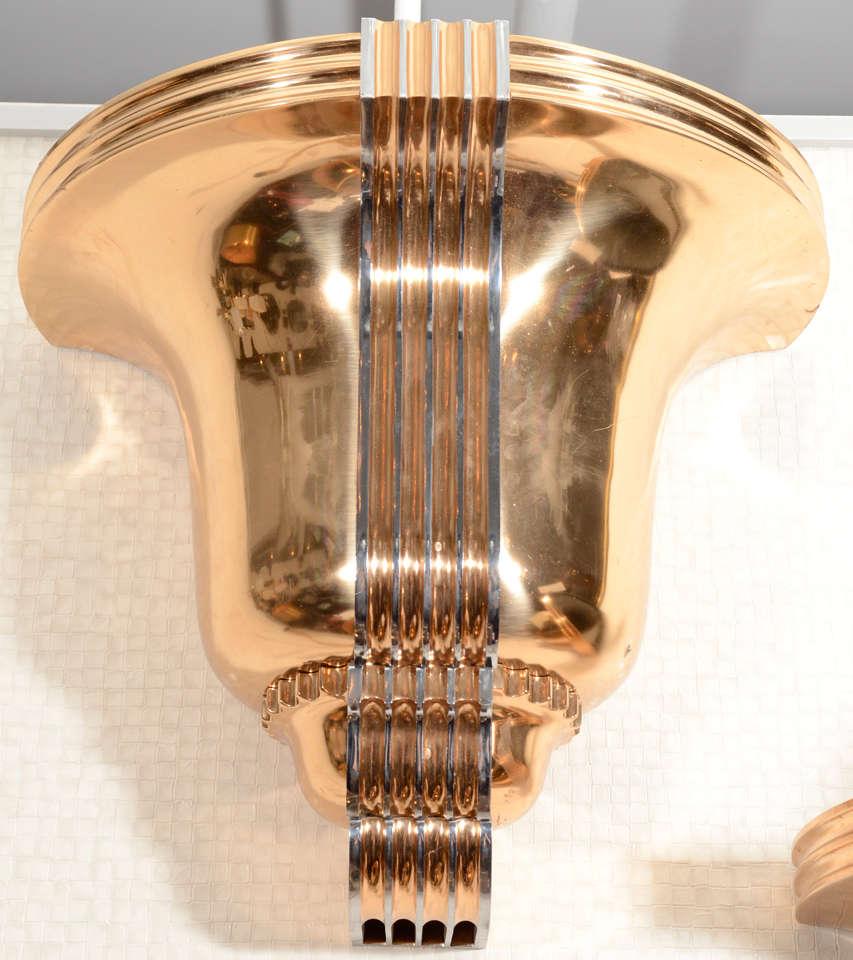 Fantastic huge pair of 1930s polished bronze sconces in the manner of Edgar Brandt.
