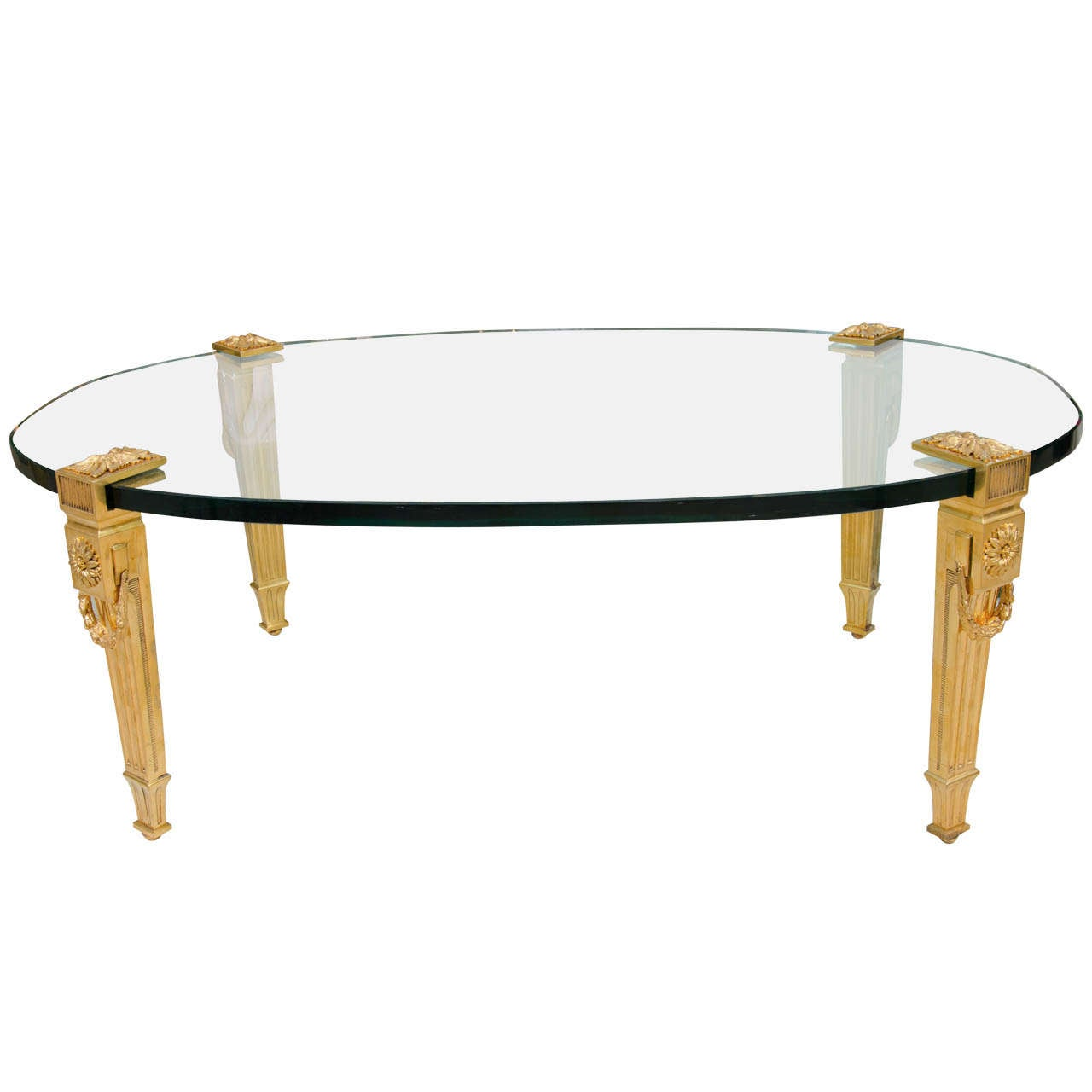 Oval glass top cocktail table with gilt bronze legs by p e for Designer cocktail tables glass