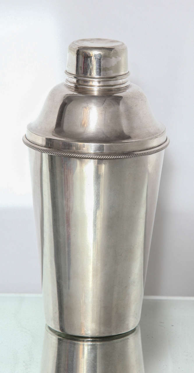 A fine silver plate vintage cocktail shaker made by Harrods of London with silver plate marks on the underside.