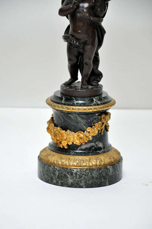 Pair of Patinated Bronze Putti Five-Light Candelabras, France, 1880 In Excellent Condition For Sale In Chicago, IL