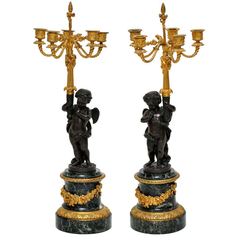 Pair of French Patinated and Gilded Bronze Winged Putti Candelabras For Sale