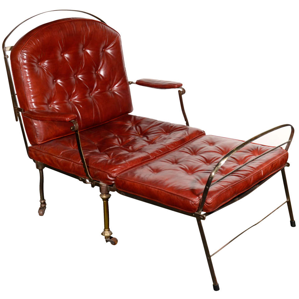 Iron and brass campaign chaise with tufted red leather at for Bernard chaise lounge