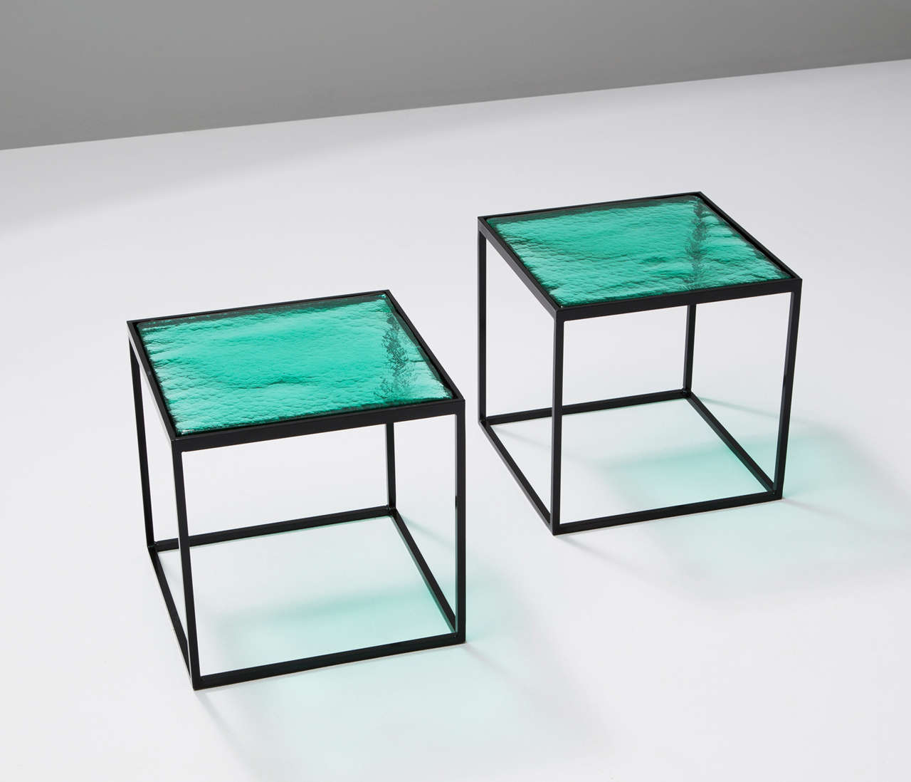 multiple green coloured glass side tables with metal box frame  - multiple green coloured glass side tables with metal box