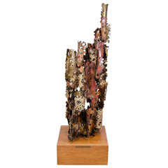 A Brutalist Mixed Metal Sculpture on a Wooden Base by Silas Seandel